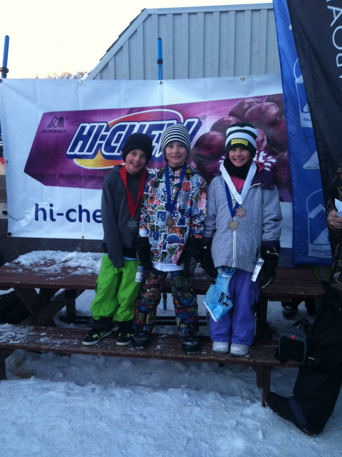 Steamboat Springs Winter Sports Club member Marty Boyd, center, celebrates after getting first place in the 8- and 9-year-old boys division in a USASA slope-style event Saturday in Vail. The Winter Sports Club got multiple top finishes.