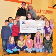 Hayden Valley Elementary School kindergarten teacher Laura Voorhees and her class pose with a check from the Peabody Energy Leaders in Education program. Peabody Energy Colorado Director of Human Resources Scott Harrell and Peabody Energy Leaders in Education Program Manager Maureen Moore, both in the back row, joined the class for the photograph.