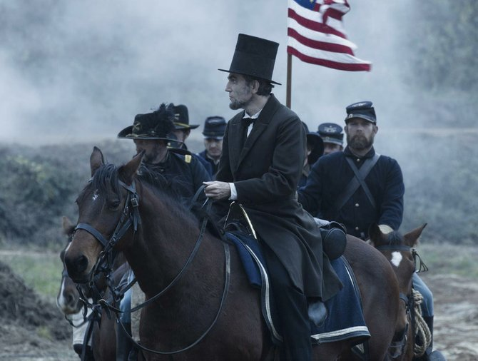 "President Abraham Lincoln (Daniel Day-Lewis) rides with a group of soldiers at a battlefield in ""Lincoln."" The movie is about the president's efforts to end the Civil War and abolish slavery. It was nominated for 12 Academy Awards."
