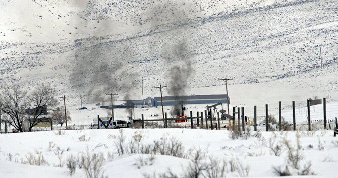 A fire near a pump jack location on Colorado Highway 394 and Moffat County Road 33 is contained. No injuries have been reported and investigators believe the heating element on a heater-treater failed, igniting the fire.
