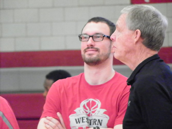 Tanner Stillwell, left, and former Steamboat Springs High School coach Kelly Meek chat during a Western State Colorado University men's basketball practice. Stillwell, a 2007 Steamboat graduate who played under Meek, is in his first year as an assistant coach for the Mountaineers.