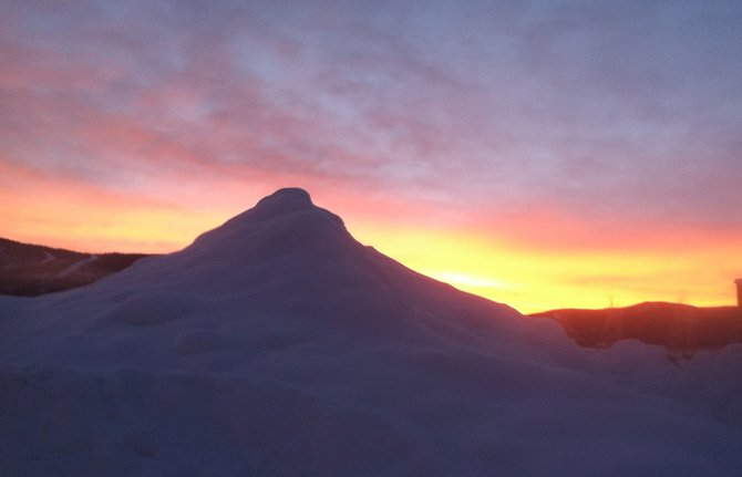The sun rose behind a small mountain of snow in a parking lot near the Steamboat Ski Area on Thursday morning. Several weather forecasters predict Steamboat will see varying amounts of new snow beginning after midnight and continuing through Friday night. Estimates range from 8 to 16 inches of new snow on the ski trails by Saturday morning.