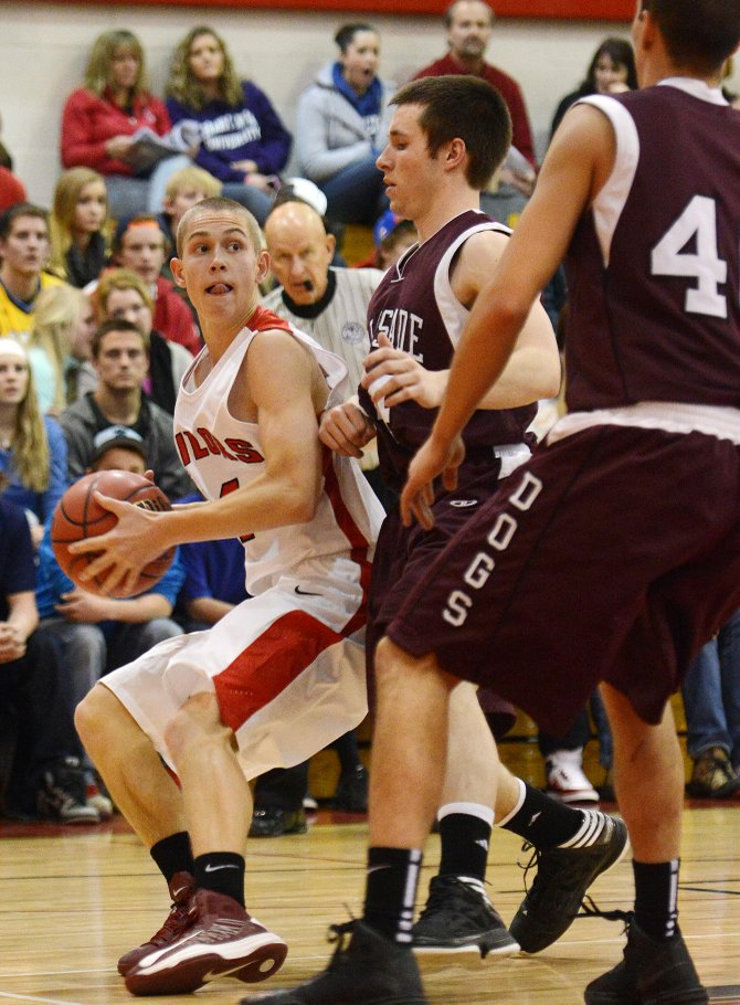 Steamboat's Carter Kounovsky runs out of room to drive in the face of the Palisade defense Friday night. The Sailors couldn't hang with the Bulldogs late, falling 41-36.