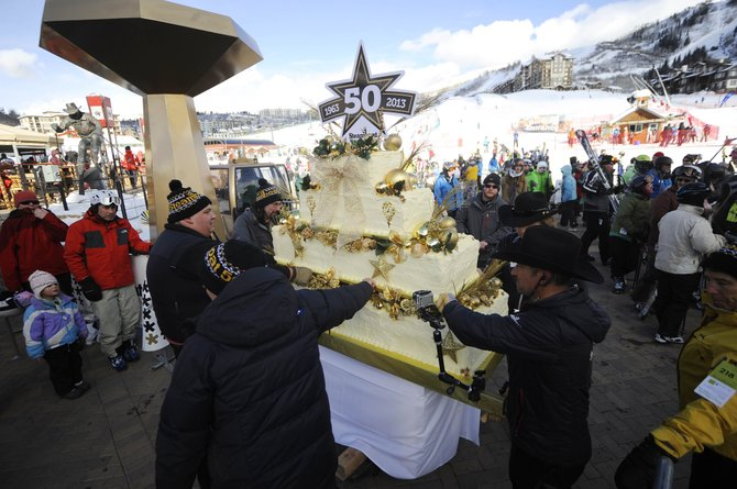 The birthday cake is moved into Gondola Square on Saturday during Steamboat Ski Area&#39;s 50-year celebration.