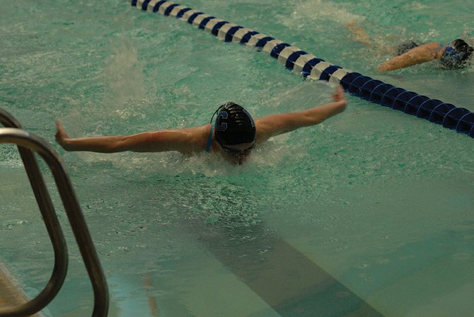 Eryn Leonard comes into the final turn of the 100-meter butterfly at the Moffat County Invite Saturday in Craig. Leonard swam her fastest time of the season and qualified for the state meet in the event.