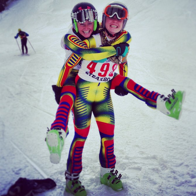 Steamboat Springs High School Alpine ski racers Suzanne Lyon and Ali Pougiales celebrate their successes in Friday&#39;s race at Howelsen Hill. Lyon won the girls race, and Pougiales was third. 