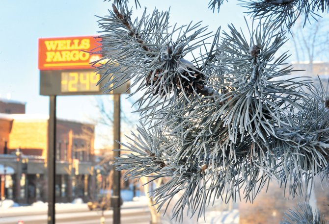 The temperature on the Wells Fargo Bank sign read minus 24 degrees in downtown Steamboat Springs shortly after 8 a.m. Monday as commuters woke up to a chilly, blue-sky morning.