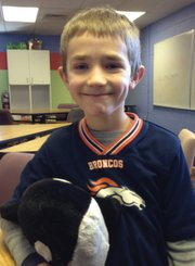 "Garrett Mercer and whale ""Sissy,"" 7, Second Grade"