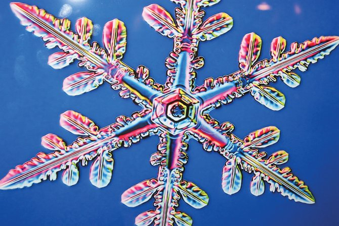 A snowflake picture by Kenneth Libbrecht hangs in the Museum of Northwest Colorado in Craig as part of the new snowflake exhibit. The exhibit, which will be viewed by area elementary school students, also includes various apparatuses for traveling in the snow.