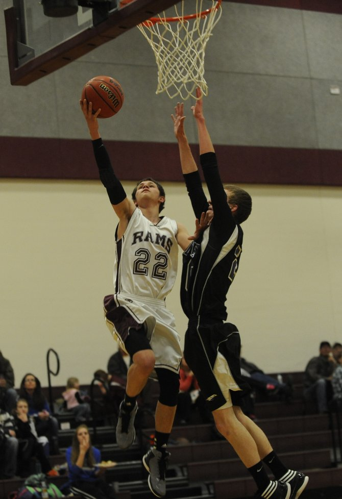 Soroco High School's Nic Paxton makes a layup Tuesday against the Denver Eagles Christian Home School. Soroco won easily, 72-26.
