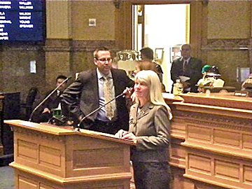 State Rep. Diane Mitsch Bush, D-Steamboat Springs, introduces a bill at the state Capitol this week as Rep. Mark Waller looks on.