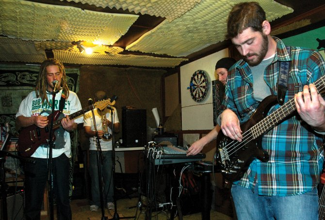 "Bradley ""Bobcat"" Leister, from left, Gerry Verdoner, Andy Pollard and Clay Martin jam during an Acutonic band rehearsal Wednesday night in a downtown Steamboat basement. The band will perform at 9 p.m. Saturday at Sweetwater Grill."