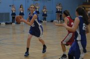 Mattie Jo Duzik looks to pass during the CMS-Rawlins eighth grade A basketball game Thursday in Craig. 