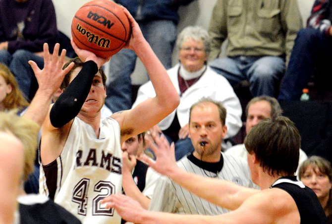 Soroco guard Matt Regan takes aim for a 3-point shot with four seconds remaining Friday against Paonia. He connected, lifting the Rams to a 71-70 win against the Eagles.