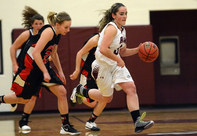 Soroco's Shelby Meyer breaks free from a gang of Paonia defenders Friday.