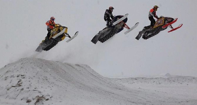 From left: A.J. Stoffle, Dylon Moss and Austin Gabbert go over a ramp at the track in Grand Lake, where they raced Jan. 5 and Jan. 12. The Snocross riders will be racing in Craig Feb. 16 at Wyman's Museum.