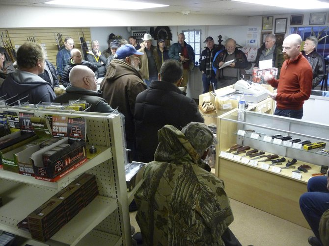 Steamboat resident Brent Lounsbury, who previously worked as a legislative aide to former House District 59 Rep. Mark Larson, speaks to concerned gun owners Saturday at Elk River Guns.