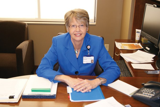 Joyce Hein, The Memorial Hospital in Craig's new interim CEO, sits at her desk Tuesday. Hein, who started at TMH this week, works as an interim CEO for Quorum Health Resources, TMH's management company, and specializes in bridging the gap between permanent CEOs.
