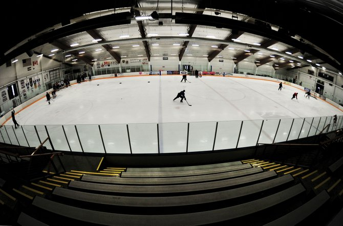 Hockey players skate across the ice at the Howelsen Ice Arena on Wednesday afternoon in Steamboat Springs. The Howelsen Hill city park/Emerald Mountain complex, which includes the ice arena, is one of the final eight projects that the lodging tax committee is considering.