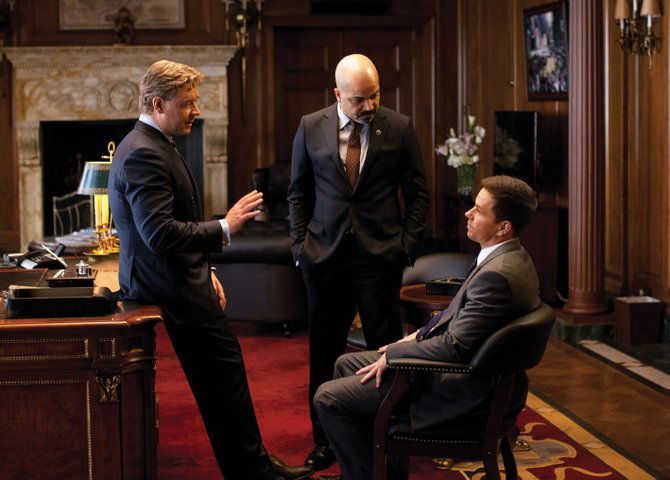 "Former New York City police officer Billy Taggart (Mark Wahlberg) meets with the mayor (Russell Crowe) and the NYPD commissioner (Jeffrey Wright) in ""Broken City."" The movie is about a cop-turned-private detective who finds himself in over his head with his latest investigation."