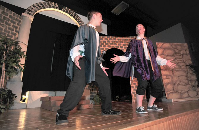 Heritage Christian School eighth-grader Jared Clark (left) and sophomore Andrea Houston share a scene while rehearsing for the school's production of Othello: A Tragic Comedy In Way To Many Acts Thursday afternoon. The schools will host a performance at 6:30 p.m. Friday night.