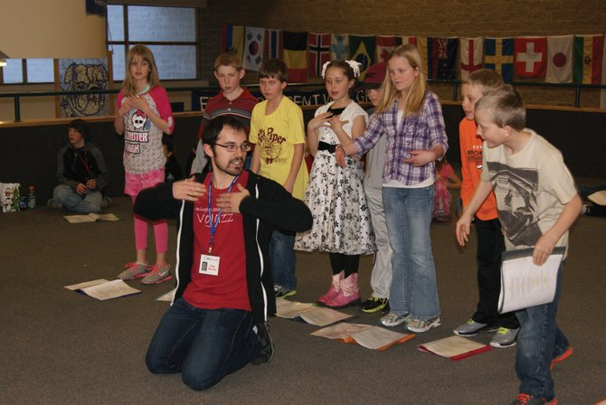 Director Sam Helmer of the Missoula Children's Theatre directs K-6 students in Craig during rehearsal for The Pied Piper production to be held Saturday in the MCHS auditorium. With auditions Monday, the students and directors have six days to memorize and perfect performances before two shows Saturday afternoon.
