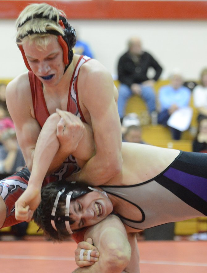 Steamboats Dane Koepfer puts the squeeze on his opponent Saturday during a wrestling tournament in Steamboat Springs. The Sailors shared first-place honors in the event with Middle Park. Koepfer finished second in his weight class.