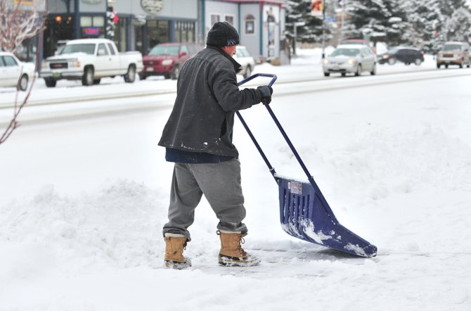 Sixto Peru was busy shoveling snow from the sidewalks in downtown Steamboat Springs on Monday afternoon. A winter storm dumped several inches of snow in the area — a trend that's expected to continue the next several days.