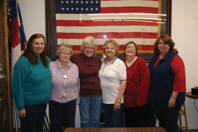 From left, Jeannie Wixson, Mary Walters, Sandy Mansfield, Virginia Cromer, Juanita Williams and Edie Eggers stand in the VFW post in Craig after their monthly meeting. The six attend almost every meeting and discuss ways to improve the Craig community.