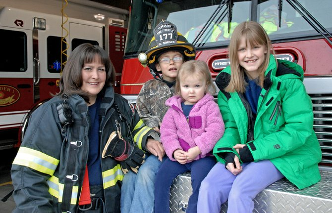 Craig Fire/Rescue firefighter Kamisha Siminoe poses with her three children at the firehouse, 419 Yampa Ave. Siminoe joined the fire department in 1999 and is currently the fourth longest tenured firefighter.