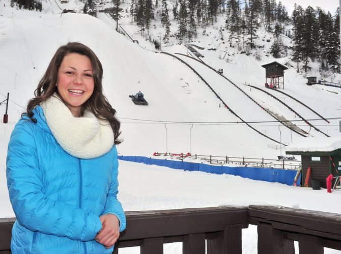 2013 Winter Carnival Queen Lucy Newman stands in front of the jumps at Howelsen Hill.