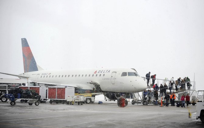 Passengers unload the Minneapolis Delta Connection flight Dec. 26 at Yampa Valley Regional Airport. Flights from Houston, Atlanta and Minneapolis were canceled Wednesday, but it was unclear whether the reason was heavy snow falling in the Yampa Valley. 