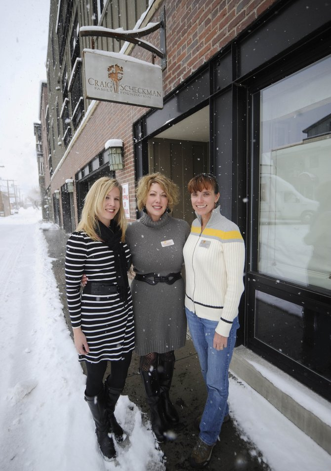 The Craig-Scheckman Family Foundation recently surpassed $1 million in giving and now will give $300,000 annually to local organizations that support special needs, at-risk and low-income youths. Pictured are Administrative Director Kris Andersen, from right, Executive Director Sara Craig-Scheckman and Administrative Assistant Angie Kimmes.