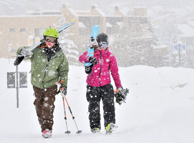 Skiers Jeff Davis and Jill Seager head to their car after a day of skiing at Steamboat Ski Area. The two skiers, who were visiting from Summit County, were thrilled about the snow and planned to stay in the area Thursday for a few more turns.