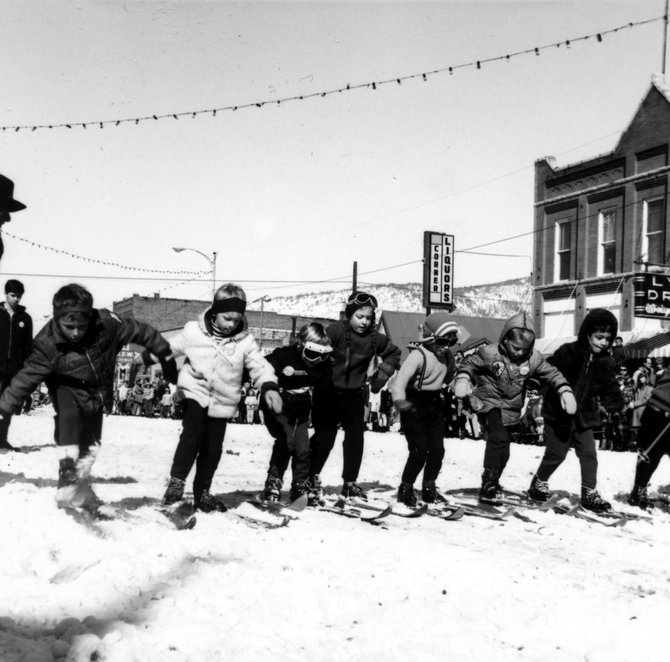 Kids participate in the three-legged race during a Winter Carnival in Steamboat Springs.