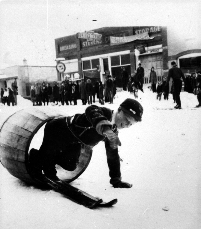 Future Olympic skier Buddy Werner, 8 years old at the time, tries the Winter Carnival barrel in 1944.