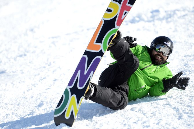 Sal Gonzalez laughs as he takes a tumble on a slope at Steamboat Ski Area on Sunday during the STARS and Stripes Heroes Camp. Gonzalez lost the lower portion of his left leg in 2004 in an IED explosion in Iraq. He said camps like this offer important opportunities for veterans to get out of their houses, achieve goals and meet people who have gone through similar situations.