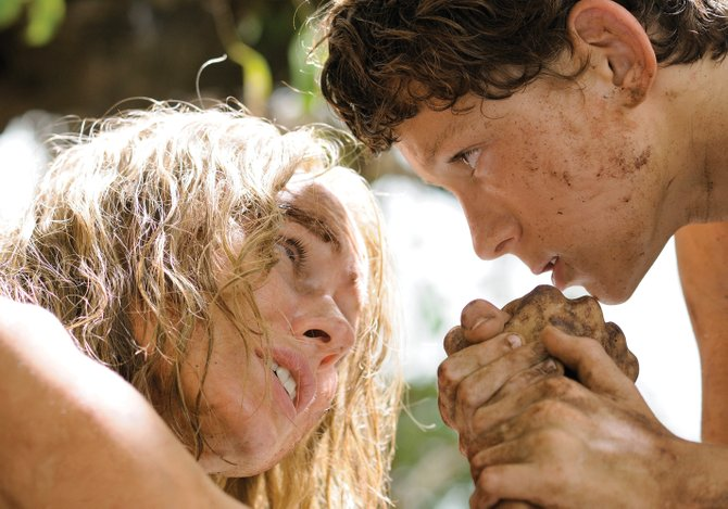 "Maria Bennett (Naomi Watts) and her son, Lucas (Tom Holland), pull together in ""The Impossible."" The movie portrays one family's experience in the aftermath of the tsunami that struck Southeast Asia in December 2004."