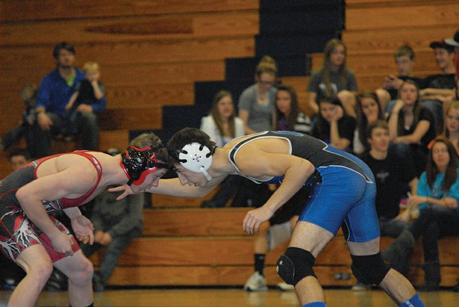Moffat County freshman Shandon Hadley squares off with Steamboat Springs High School's Nathan Parks on Thursday in Craig.
