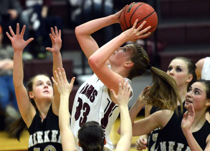 Soroco sophomore Jessica Rossi puts back up an offensive rebound for a bucket in the midst of Meeker traffic Friday. The Rams played three solid quarters, but their lapses in the remaining quarter kept the game from being close. Meeker won, 54-37.