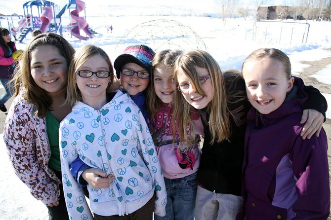 Ridgeview Elementary School fourth graders Tessona Gonzalez, Kiersten David, Tressa Otis, Kaci Dunlap, Kelsey McDiffett and Alayna Behrman enjoy a cold day on the playground.