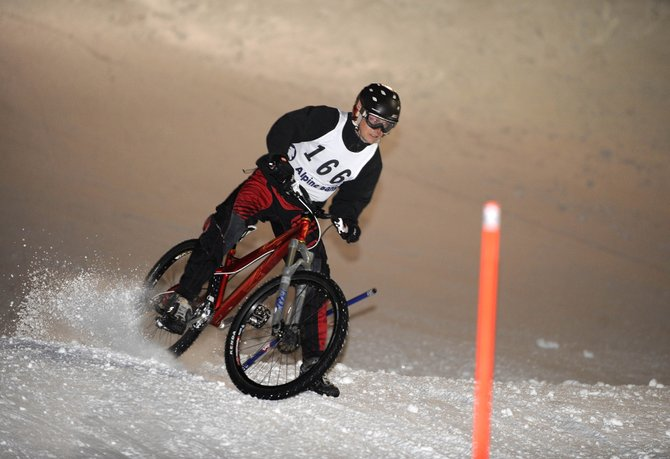 Trevyn Newpher comes down the face of Howelsen Hill during the dual slalom bicycle race Friday night. Newpher won the race.