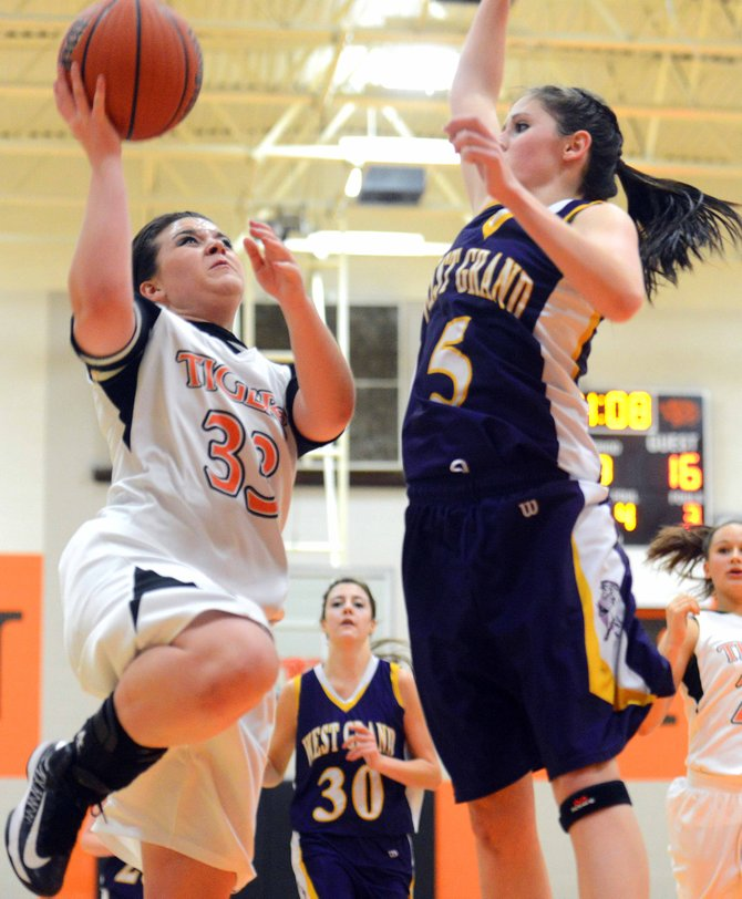 Kayla Dunckley goes for a layup Friday against West Grand. The Tigers won their third game of the season, beating West Grand, 51-36.