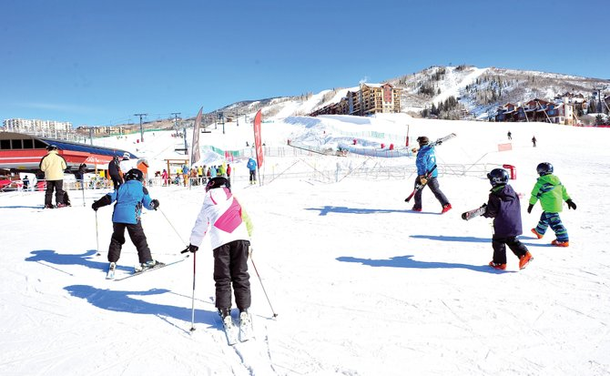 Skiers head to the lifts in January at Steamboat Ski Area. A former Harley Davidson executive on Wednesday told ski area officials they need to inspire their guests to go home with the stories of a lifetime in order to avoid becoming mere commodities.