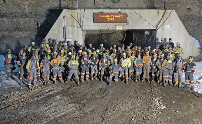 Employees of Twentymile Mine stand in front of the underground operation's new entry portal. This week, executives from Peabody Energy presented Twentymile with the 2012 President's Safety Award.