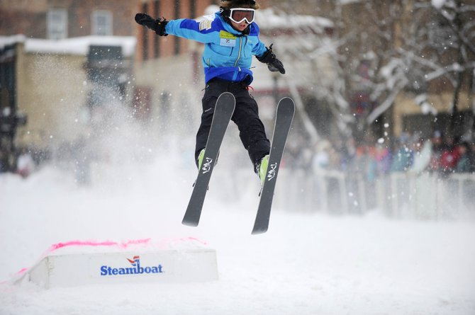 Logan Spiegel flies through the air during the Steamboat Springs Winter Carnival donkey jump competition on Lincoln Avenue. Logan won the competition after jumping 48 feet, eight inches.