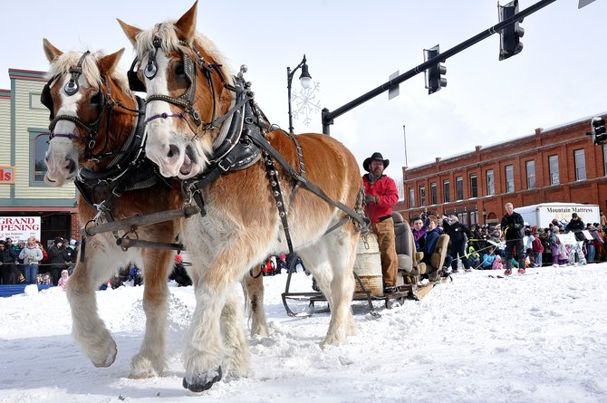 Draft horses like this team driven by rancher Doug Monger were the stars of the 100th Winter Carnival parade.