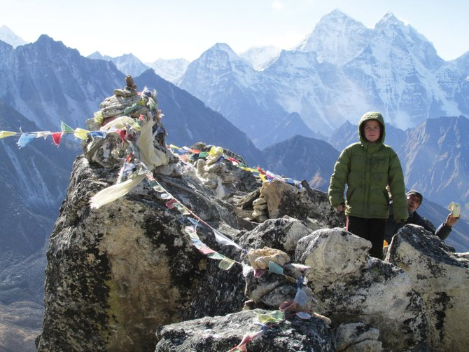 Kessler Patterson stands with a Sherpa in the Himalayan mountains during a month long trip to Nepal last December. Ten-year-old Kessler went with his father Scott.