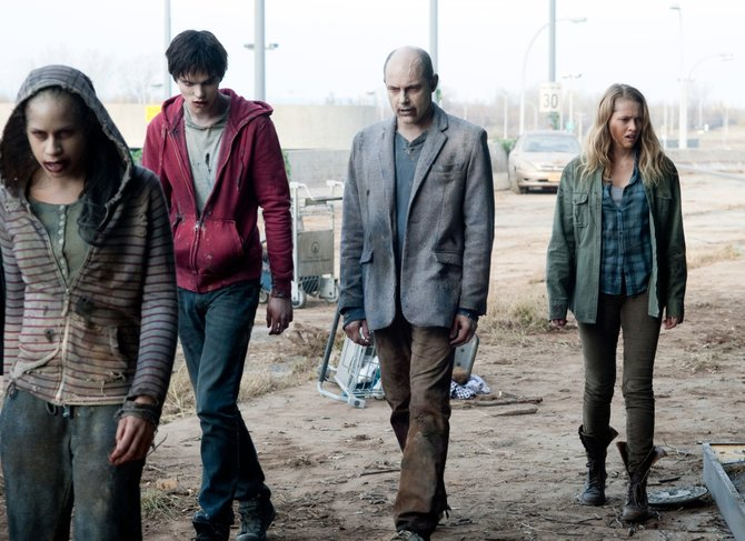 "Apocalypse survivor Julie (Teresa Palmer) attempts to blend in with zombies R and M (Nicholas Hoult, Rob Corddry) in ""Warm Bodies."" The movie is about a zombie who starts to come back to life after falling in love with a young woman."