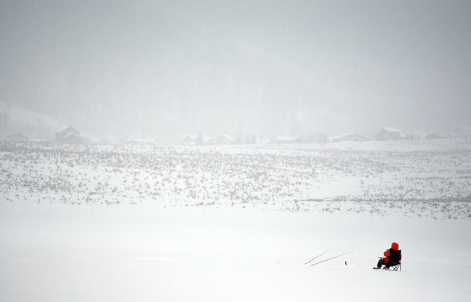 An ice fisher waits patiently for a catch Thursday on Stagecoach Reservoir. The Colorado Division of Parks and Wildlife and Steamboat Great Outdoors will sponsor an ice fishing tournament on the frozen reservoir Sunday.